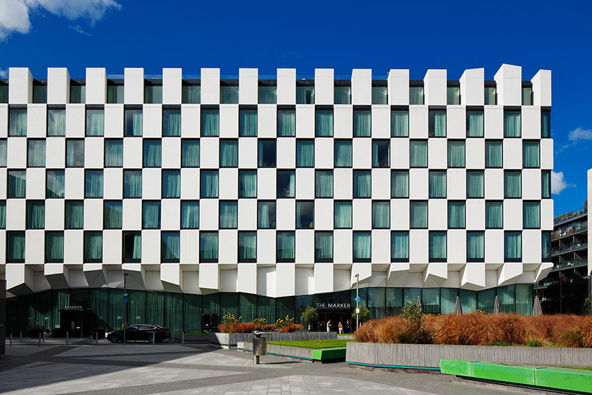 With-an-ultra-modern-checkerboard-facade,-this-hip-hotel-overlooks-Grand-Canal-Square-in-the-trendy-Docklands-business-district,-directly-opposite-Bord-Gáis-Energy-Theatre.